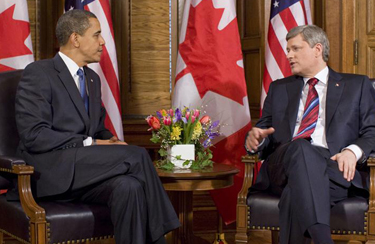 President Obama discusses with Prime Minister Stephen Harper, source Wikipedia.org