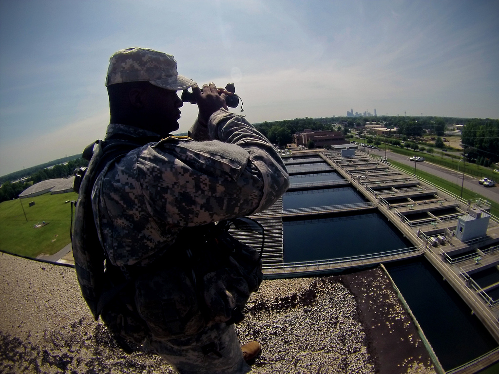 Charlotte, N.C. Sgt. Naquian McDaniel, of Bravo Company, 1-252 Armor, plays his role as a Rapid Reaction Force Soldier, providing security during an exercise by observing from atop the Franklin Water Treatment Plant main building. The The RRF exercise is an opportunity for the North Carolina National Guard to highlight special skills to provide valuable support to our communities, throughout the state, during catastrophic homeland events. NCNG photo by Tech. Sgt. Brian E. Christiansen.