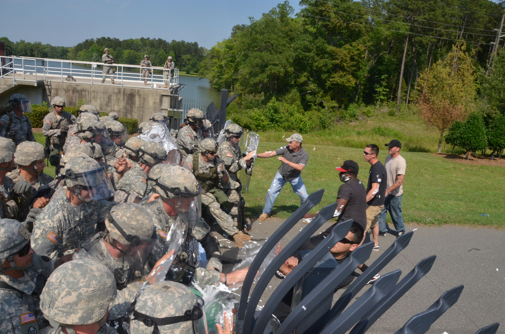 CHARLOTTE, N.C. – Soldiers of the North Carolina National Guard train for Rapid Reaction Force duty at the Catawba River Pump Station here today. The training scenario tests the Soldiers ability to use nonlethal force to disperse a crowd of aggressors from a water plant. This training prepares the Soldiers to support state and local first responders and county emergency management agencies. The RRF is a quick reaction team that, on order, is deployable anywhere in North Carolina within 24 to 36 hours of a critical event. In times of crisis, the RRF may be ordered by the President of the United States or the Governor of North Carolina in order to augment Federal or State Authorities in response to actions such as a known terrorist attack, civil unrest or a natural and/or man-made disaster. (U.S. Army National Guard photo by Sgt. 1st Class Robert Jordan / released)