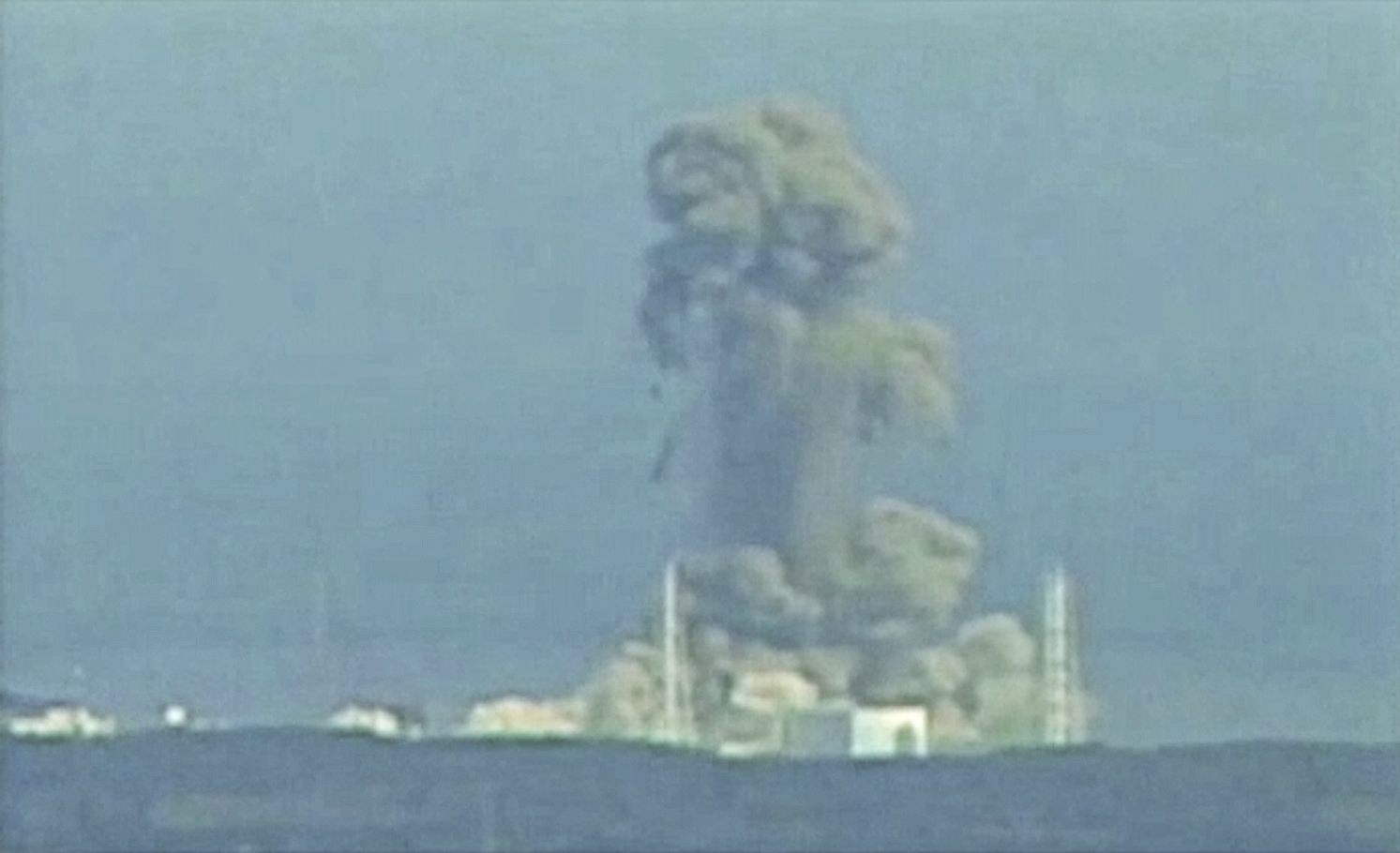 Fukushima Japan  city photo : Smoke rises from Fukushima Daiichi nuclear power complex in this still ...