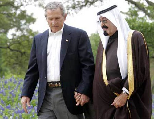 "Image:  Former-US President George Bush and King for Life of Saudi Arabia, Abdullah bin Abdulaziz al Saud:""The loving parents of Al Qaeda."" From the 1980's to present day, the US and Saudi Arabia have funded, armed, and directed Al Qaeda while performing propaganda campaigns to bend public perception regarding the terrorist organization - portraying them as heroes, then villains, and back again. The ""War on Terror"" is a fraud."