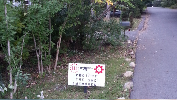 Photos: New York Cop Steals Residents Pro Second Amendment Signs copsteal4