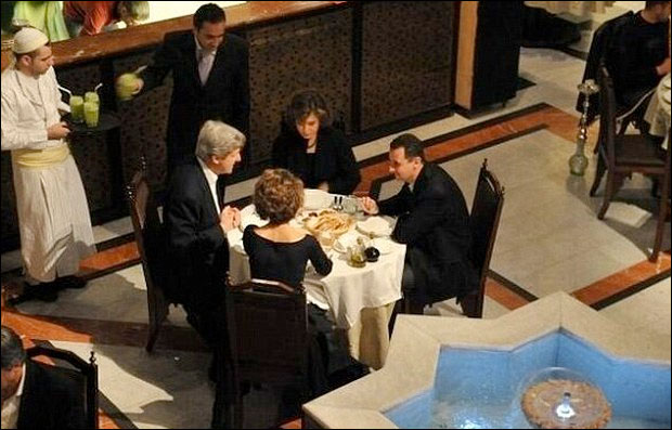 John Kerry dines with Bashar al-Assad.