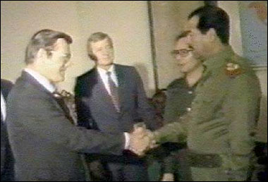 Video capture of Donald Rumsfeld shaking hands with Saddam Hussein.