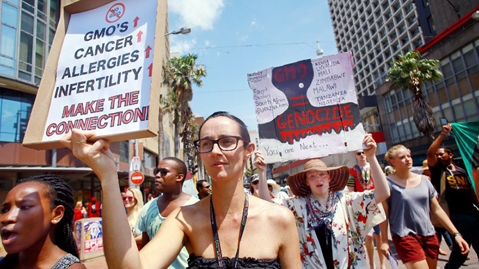 Activists carry signs during a protest against chemical giant Monsanto in Durban on October 12, 2013. (AFP Photo / Rajesh Jantilal)