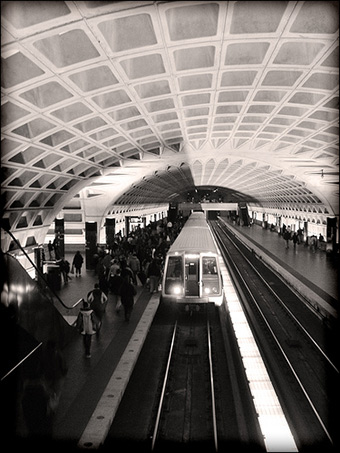 A Washington, D.C. Metro rail line pulling into a station. Credit: laffy4k via Flickr