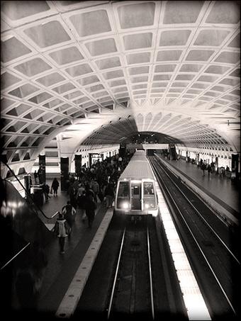 A Washington, D.C. Metro rail line pulling into a station. Credit: laffy4k via Flickr