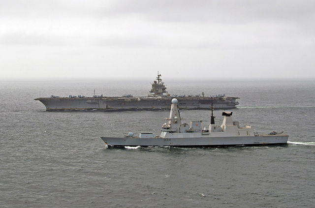 USS Enterprise sails alongside Type 45 destroyer HMS Diamond as the two vessels exercised together in the Middle East / 8 August 2012