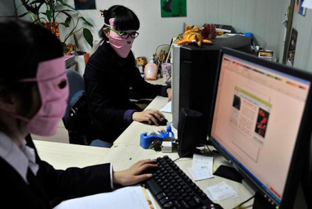 Chinese women are buying up variations of these bizarre face masks to wear indoors, in hopes of combating radiation emitted by computer screens.  Kotaku/ Eric Jou