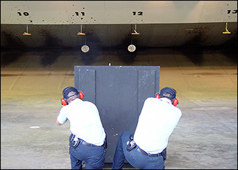 Federal agents conduct firearms training at a range in Georgia.
