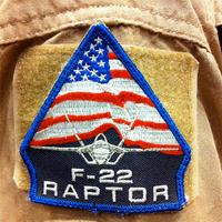 A badge worn by Bret Luedke, a F-22 test pilot.  Credit: Charles Atkeison via Flickr