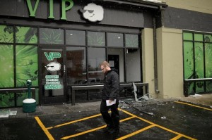 A customer walks away from VIP Cannabis at 2949 W. Alameda Ave. in Denver on Nov. 21, 2013. Federal officials raided the shop Thursday. (Hyoung Chang, The Denver Post)