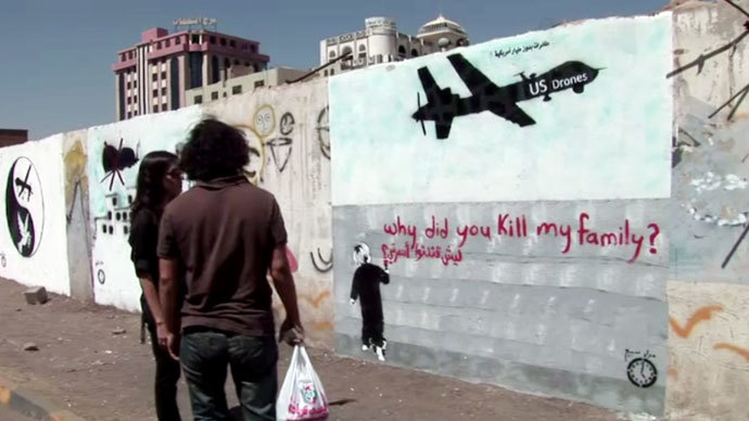 Graffiti on one of the walls in the Yemeni village of Khawlan, a small farming community ravaged by a drone attack.Screenshot from RT video