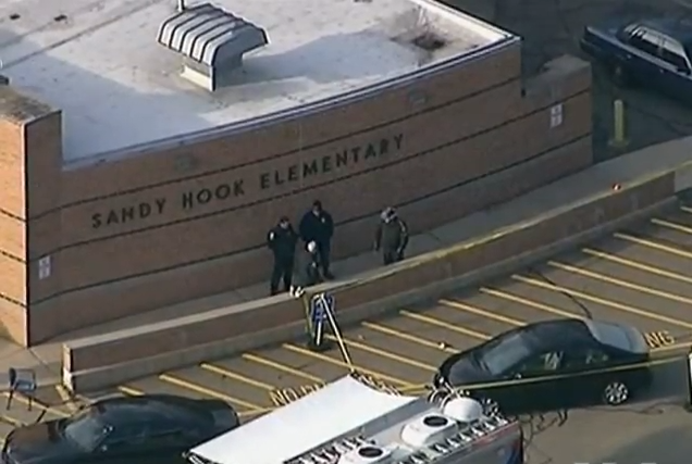 Police arrive at Sandy Hook Elementary, after  shooting on December 14, 2012.