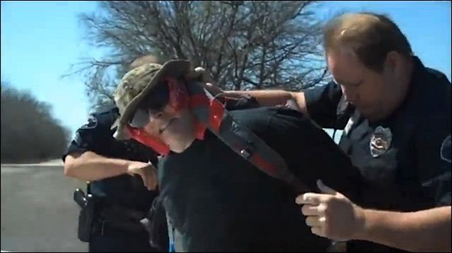 Video taken by Grisham's son shows him being disarmed and arrested.