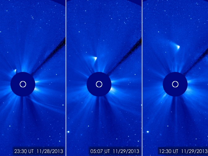 Three view of what's left of Comet ISON rounding the sun. ISON appears as a white smear heading up and away from the sun. ISON was not visible during its closest approach to the sun, so many scientists thought it had disintegrated, but images like this one from the ESA/NASA Solar and Heliospheric Observatory suggest that a small nucleus may be intact. / Image Credit: ESA/NASA/SOHO/GSFC