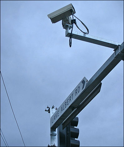 Traffic camera on a traffic light pole, via Wikimedia Commons