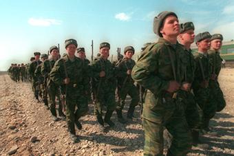 Russian troops marching through Chechnya Credit: kremlin.ru