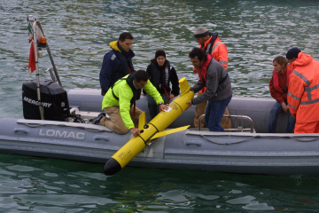 Putting a Slocum Glider into the sea during a NATO exercise. Read more: Navy's ocean-powered drone helps it wage underwater war.