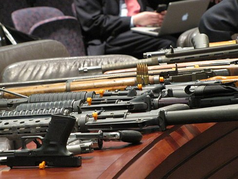 Guns displayed at a hearing earlier this year by the state police / Hugh McQuaid file photo