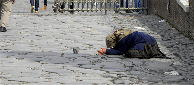 A beggar bows down low for a few coins in Rome. Credit: ian-w-scott via Flickr