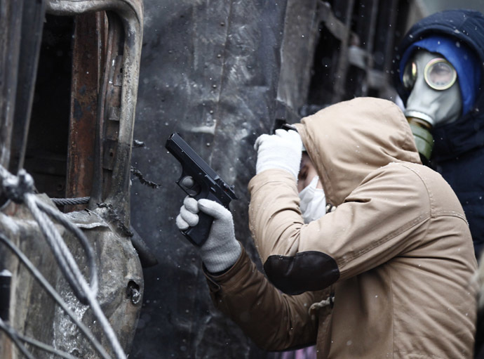 A pro-European protester holds a pneumatic gun during clashes with Ukrainian riot police in Kiev January 22, 2014. (Reuters/Vasily Fedosenko)