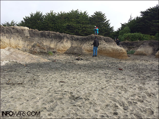 Jakari takes readings of bluff and black silt areas.
