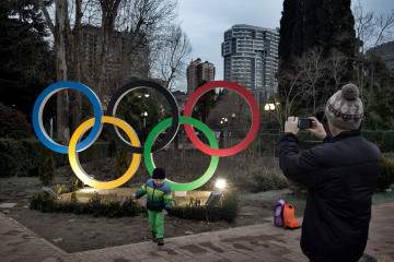 A child plays near an Olympics logo in Sochi, Russia, Jan. 16, 2014. / Yuri Kozyrev / NOOR for TIME