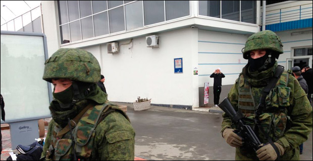 Unidentified soldiers patrol outside Simferopol International Airport on February 28, 2014.