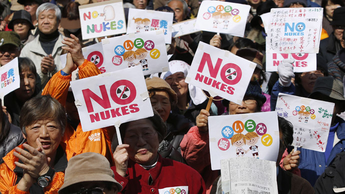 "Anti-nuclear protesters hold banners saying ""No Nukes"" before they march in Tokyo March 9, 2014.(Reuters / Yuya Shino)"