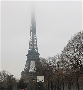 The Eiffel Tower and other landmark buildings in Paris have disappeared in a milky fog.