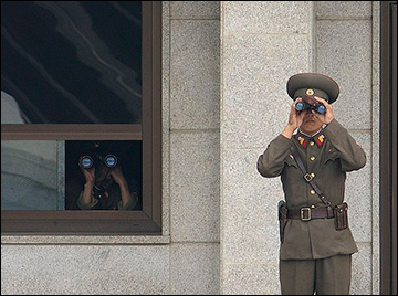 N. Korean soldiers peer southward / Credit: Wikimedia Commons