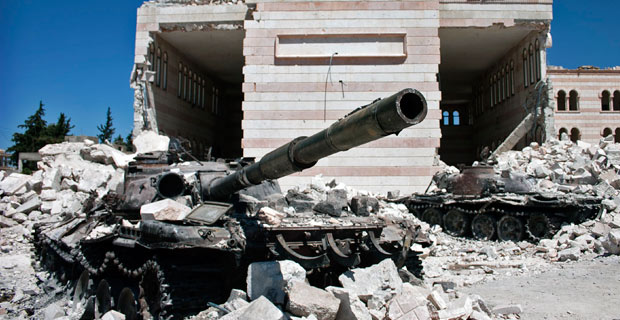 Two destroyed tanks outside a mosque in Azaz, Syria.  Credit:  Christiaan Triebert / Flickr