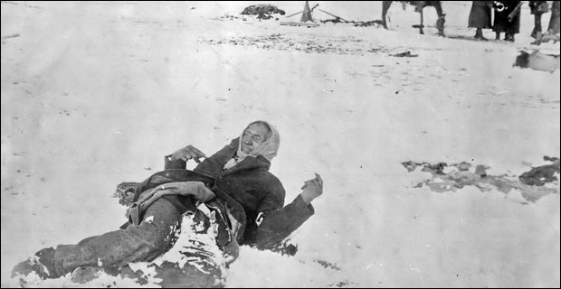 """The final flickers of Indian resistance were extinguished by Leviathan in the bloody snows of Wounded Knee."" Photo: The slain body of Chief Big Foot propped up in the snow at Wounded Knee."