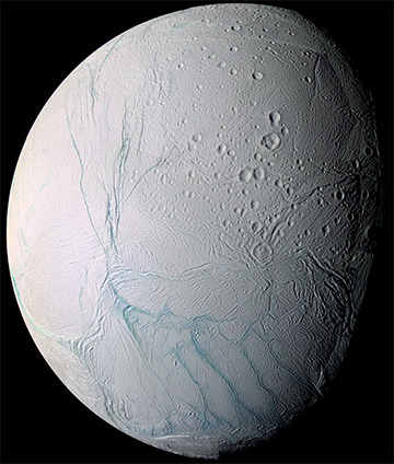 From afar, Enceladus exhibits a bizarre mixture of softened craters and complex, fractured terrains. / Credit: Nasa
