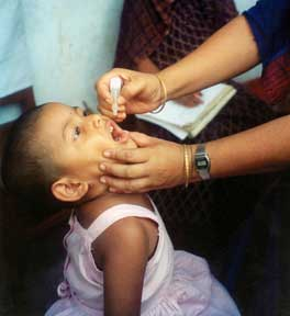Child receiving polio vaccine.