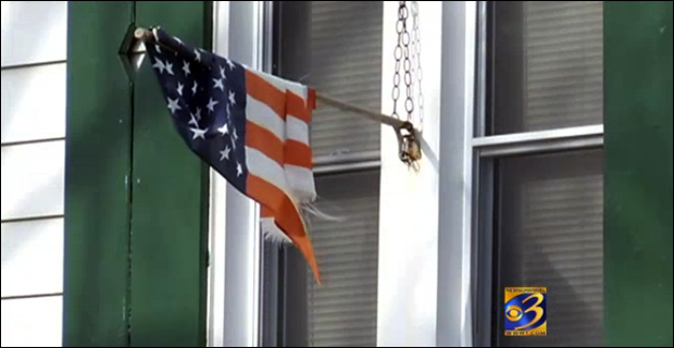A tattered flag hangs at the Handley home / Credit: WWMT
