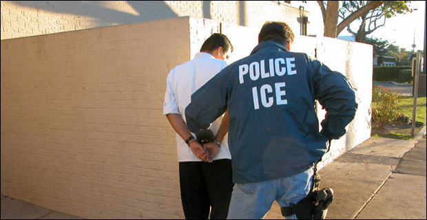 A U.S. Immigration and Customs Enforcement agent arresting a suspect.