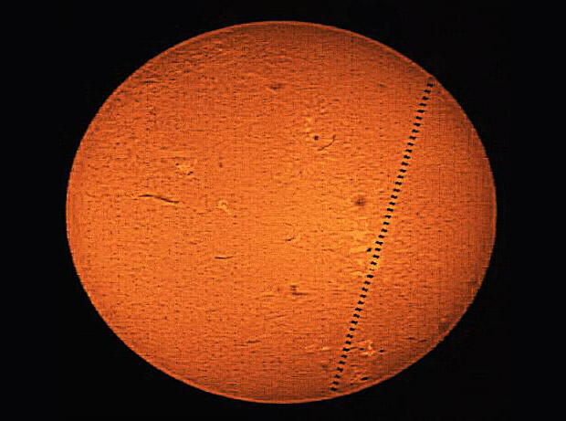 A mosaic of 46 images showing the transit of the ISS across the sun visible from southwest London on May 16, 2014 at 06:23 UT. Credit: Roger Hutchinson.